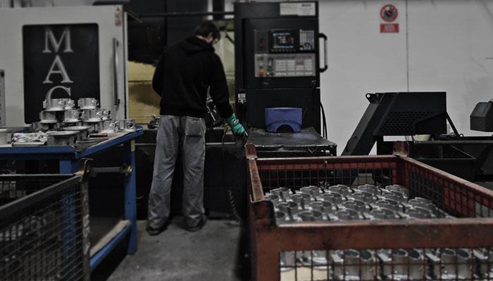 working on cnc machine in Erredue Group
